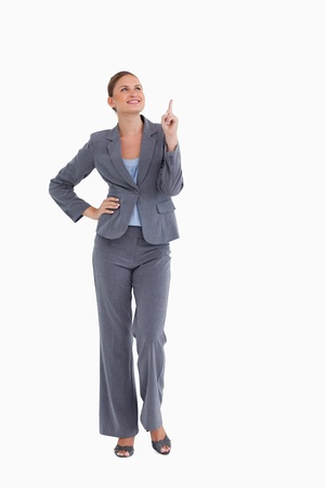 tradeswoman: Smiling tradeswoman looking and pointing up against a white background