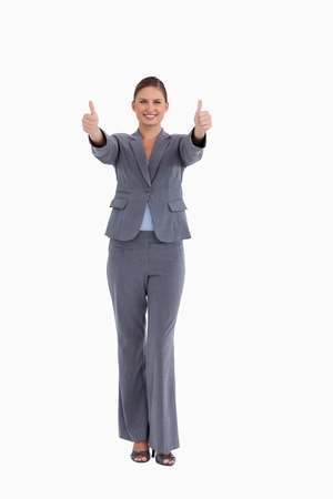 Smiling tradeswoman giving thumbs up against a white background Stock Photo - 13651505