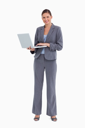 Smiling tradeswoman with her notebook against a white background photo