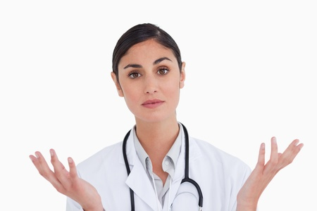Close up of confused female doctor against a white background Stock Photo - 13652635