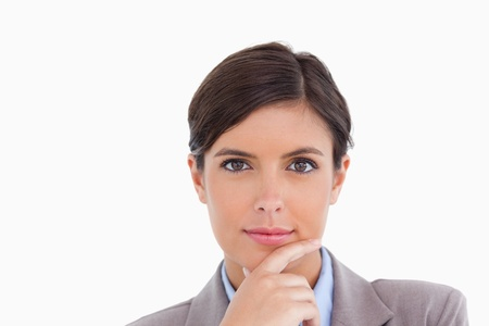 thinkers: Close up of female entrepreneur in thinkers pose against a white background Stock Photo