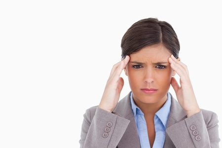 Close up of female entrepreneur having a headache against a white background photo
