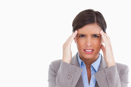 Close up of female entrepreneur experiencing a headache against a white background photo