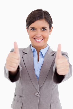 Close up of female entrepreneur giving thumbs up against a white background Stock Photo - 18681731