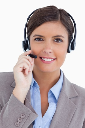 Female call center agent with headset against a white background Stock Photo - 13675371