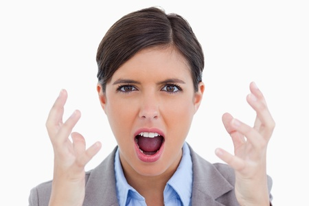Close up of angry shouting entrepreneur against a white background photo