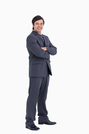 Smiling tradesman with arms folded against a white background photo