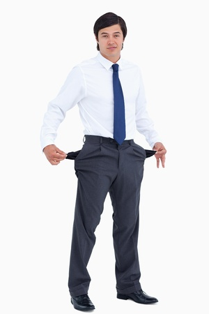 Tradesman showing his empty pockets against a white background photo