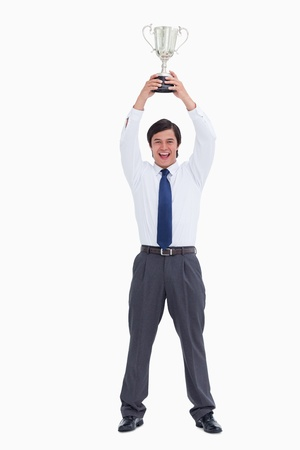 Successful tradesman holding cup against a white background photo