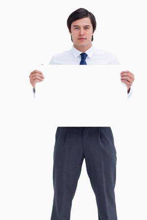 Tradesman holding blank sign against a white background photo
