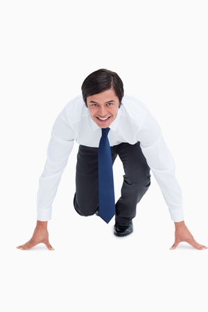 Smiling tradesman in sprinting position against a white background Stock Photo - 13651514