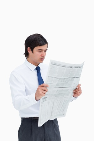 Young tradesman reading the news against a white background photo