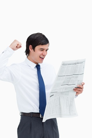 Celebrating tradesman looking at the news against a white background Stock Photo - 13653252