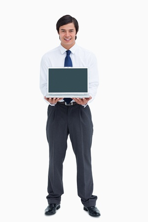 Smiling tradesman presenting screen of his laptop against a white background photo