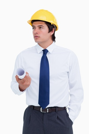Male architect with helmet and plans looking to the side against a white background photo
