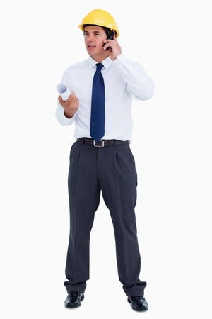 Male architect on his cellphone against a white background photo