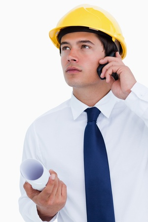 Close up of male architect listening to caller against a white background photo