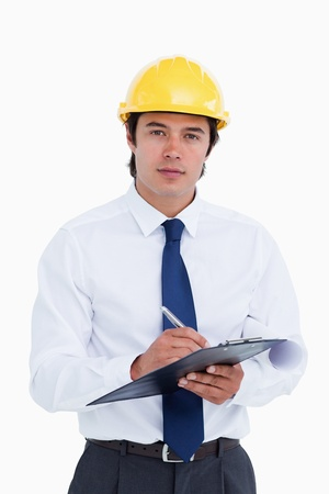 Male architect with clipboard and pen against a white background photo
