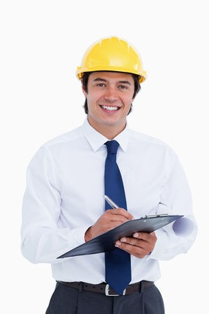 Smiling male architect with clipboard and pen against a white background photo
