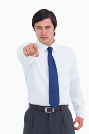 Young tradesman pointing at camera against a white background photo