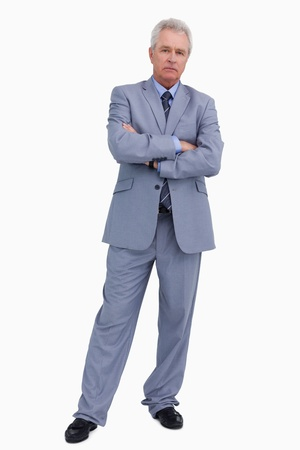 Mature tradesman with his arms folded against a white background photo