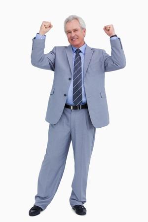Successful mature tradesman celebrating against a white background photo