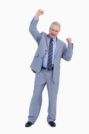 Cheering mature tradesman with arm risen against a white background photo