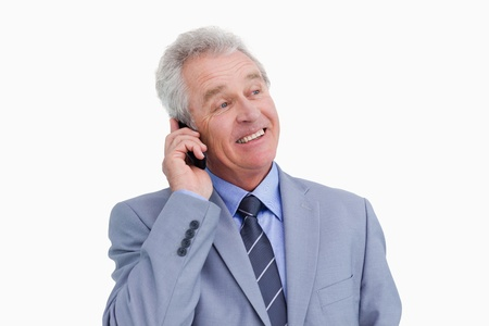 Close up of mature cheerful tradesman on his cellphone against a white background Stock Photo - 13653482
