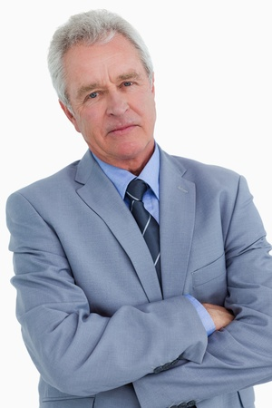 Close up of mature tradesman with his arms folded against a white background photo