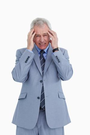 Mature tradesman having a headache against a white background photo