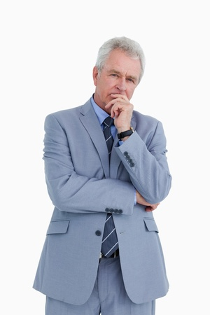 Mature tradesman in thinkers pose against a white background photo