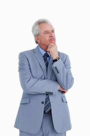 Thoughtful mature tradesman against a white background photo