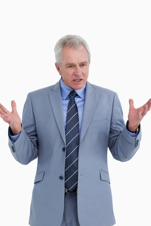 Clueless mature businessman against a white background Stock Photo - 13653370