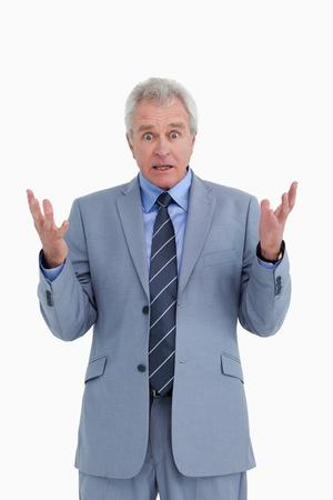 baffled: Shocked mature tradesman against a white background Stock Photo