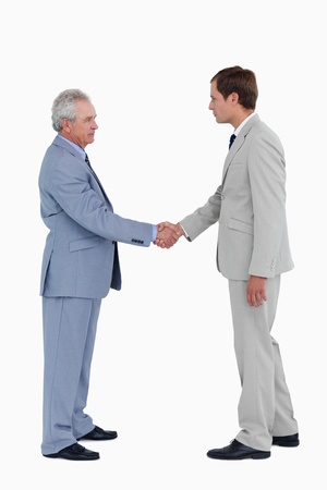 Side view of tradesmen greeting against a white background photo