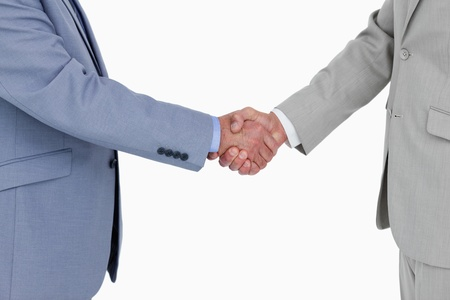 Side view of shaking hands against a white background photo