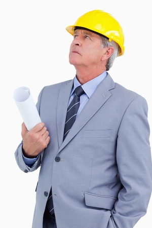 Close up of mature architect taking a close look against a white background photo