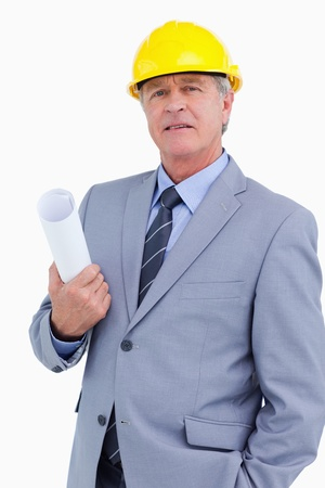 Confident mature architect with helmet and plans against a white background photo