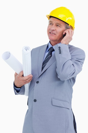 Mature architect on his cellphone against a white background photo