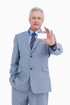 Mature tradesman showing his business card against a white background photo