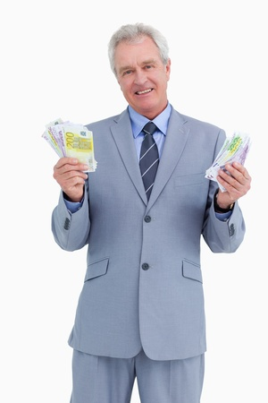 Mature tradesman showing his profit against a white background photo