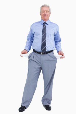 Mature tradesman showing his empty pockets against a white background photo