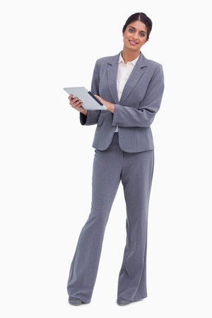 Smiling female entrepreneur with tablet computer against a white background Stock Photo - 13653100