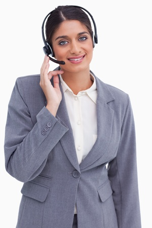 Smiling female call center employee against a white background photo