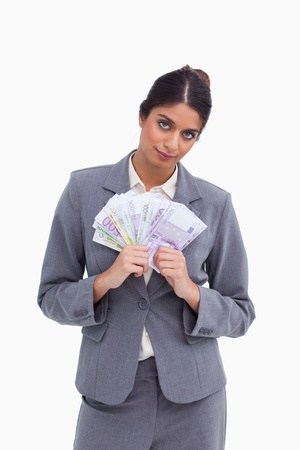 Female entrepreneur holding bank notes against a white background photo