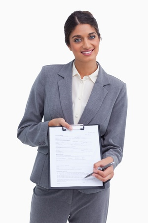 Smiling female entrepreneur asking for signature against a white background photo