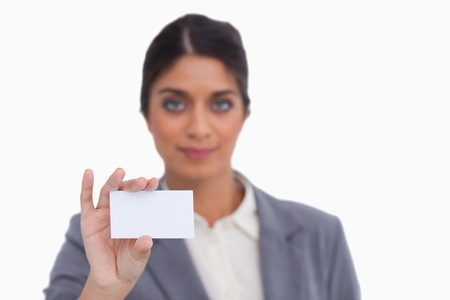 Female entrepreneur showing her business card against a white background photo