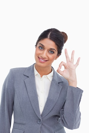 Female entrepreneur giving her approval against a white background photo