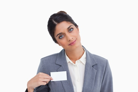 Female entrepreneur pointing at name sign against a white background photo