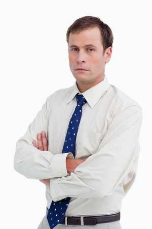 Close up of serious businessman with his arms folded against a white background photo